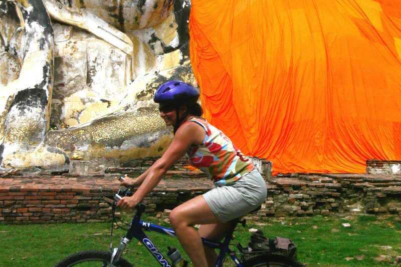 Woman Cycling in Ayutthaya